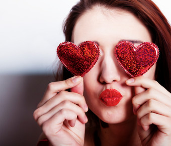 woman with red hearts over her eyes