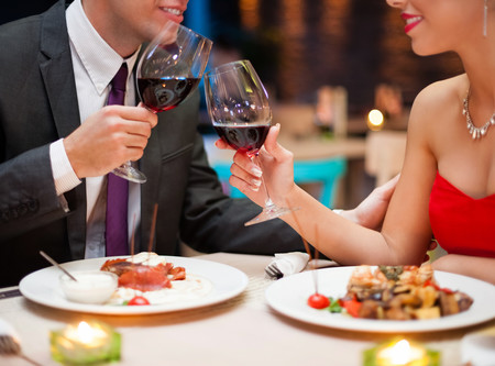 couple celebrating Valentine's Day with fancy dinner